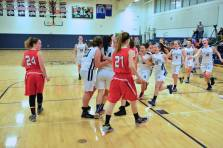 After Rose scores her 1000th point, the game is stopped as her teammates storm onto the court to congratulate her and hold a brief ceremony.
