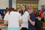 RHS SGC member, Hannah Murphy, poses with other SEMASC attendees while filling Care Packs for soldiers serving overseas.