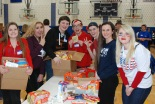 RHS SGC member, Haley Macray, poses with other SEMASC attendees while filling Care Packs for soldiers serving overseas.