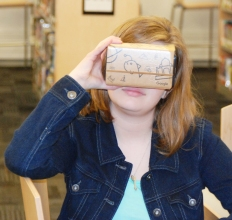 Callie Gillian looks through the Google viewer. photo by Hannah Boben
