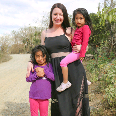 Julia with children in village where her team of volunteers teach about hygiene. photo courtesy of Julia Rayberg.