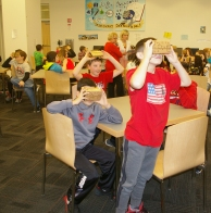 Gale Burke and Leah Ouderkirk with 6th graders go on their Google Expedition on March 8 in the RMS library. photo by Michelle Downey