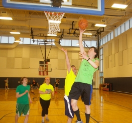 Patrick Finn goes to the hoop against Dr. Cron while Ryan Struzziery and Caitlin Yannizzi look on.