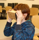 6th grader, Connor O'Regan looks at the Tolbachik Volcano in his virtual reality viewer. photo by Michelle Downey