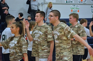 Danielle O'Brien, Steve Norris, John Gorman at the unified basketball game.
