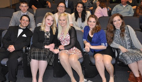 Seniors await judges' decision after their speeches at the Spellman Oratorical Contest on Tuesday, April 12.  Front row l to r: Mark Ewell, Haley Macray, Meghan Foster, Leah DeCecco and Ashley Pezzella. Back l to r: Brad Gasdia, Celia Rosa and Bella Rindone.  Veritas Photo.