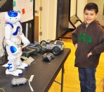 2nd grader Gus interacts with NAO the robot at the Arts Festival. Veritas photo.