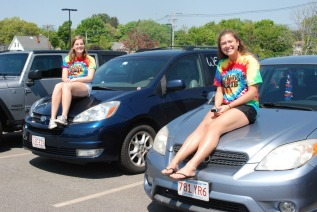 Sarah Margolis and Lexie Carchedi show off their decorated cars.