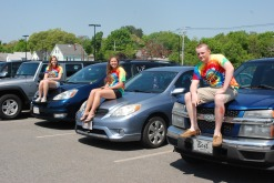 Sarah Margolis, Lexie Carchedi, and Mike Ahern show off their decorated cars.