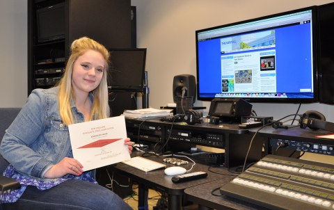 Haley Macray, senior managing editor of the Veritas with the All-New England first place certificate received by the Veritas on May 2