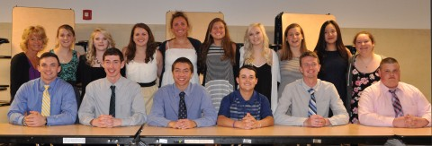 Mrs. Black (left) with senior NHS members: Kylie McKenna, Haley Macray, Kaitlin Dorney, Caroline Kilduff, Lexie Carchedi, Meghan Foster, Sarah Margolis, Fanting Zhou, Celia Rosa. Kevin Levesque, Matt Kirslis, Ryan Sugrue, Mark Ewell, Jared Ochenduszko, Tom Spengler photo by Zach Pransky