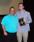 Mr. Liquori presents Harrison Shields with the JOHN BELL AWARD.