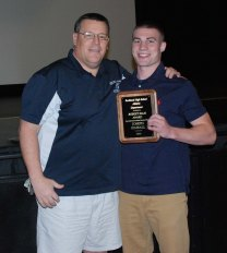 Mr. Damon presents Joe Kimball with the ROBERT ELLIS AWARD given to a top student athlete/basketball player.
