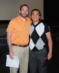 Mr. MacAllister presents Jonathan Nguyen with the WARREN NAJARIAN AWARD for the athlete who never gives up.