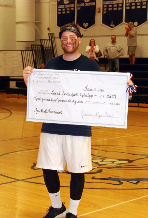 Ryan Quirk holds a copy of the check for $3,800 dollars raised for his brother, Jared's Memorial Scholarship Fund at the second annual speedball tournament on June 8-10. photo by Hannah Boben