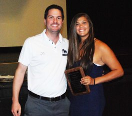 Mr. Johnson presents Samantha DeMarco with the WOMEN'S COACHES' AWARD for a Senior Female Athlete.