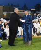 Mark Norris gives his son Steve Norris his diploma.