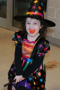 Little girl dressed as a witch