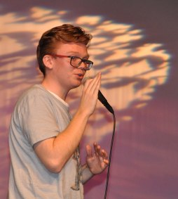 Evan Murphy does a comedy act for the audience at Mr. Rockland competition. photo by Maddie Gear