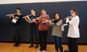 The RHS flutists perform the National Anthem at the pep rally. photo by Maddie Gear