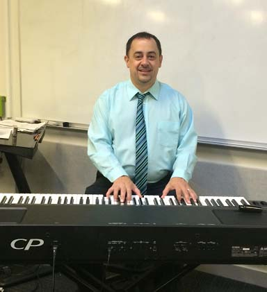 David Arruda brings experience to the music department as part-time chorus teacher. photo by Maddie Gear