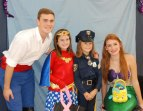 Adam Royle and Kaylee Patten with two trick or treaters.