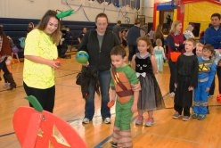 Brianna Peppino supervises kids playing a beanbag game.