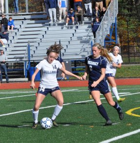 #14 Madison Blonde has the advantage over a Cohasset defender.