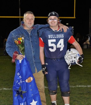 Jake Hughes with his dad, Paul