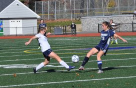 #24 freshman Lauren Buker who scored the second goal of the game goes against senior Nikki Federle at midfield.