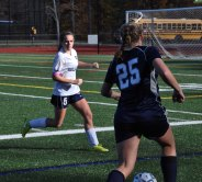 Emily Beatrice thwarts an advance by Cohasset's Sophie Swartwood.