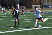 Grace Oliver gets ready to pass the ball ahead from the left side in the second half.