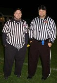 Officials were wrestling coach, Peter Harrison, left, and football coach Damien Ricci.
