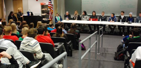The alumni panel in the lecture hall answered questions about their college experiences.