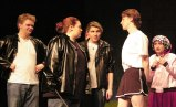 Danny (Ryan Struzziery) joins the track team while Doody (Mike Bodley), Sonny, (Kellie Berry) Kenickie (Shandi Austin) and Frenchy (Jurnee Dunn) look on in disbelief.