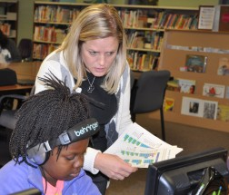 Mrs. Rachel Gear gives instruction to Esten 3rd grade student Jamie Charles. photo by Maddie Gear