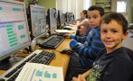 Aaron Ramponi (front), and Flynn Smith pause as they go through their tutorials for creating code for a Star Wars game. Students in all Rockland school participated in the global initiative called an Hour of Code as part of Computer Education Week. Aaron and Flynn are 3rd grade students of Lisa Ryan and Rachel Gear at Esten Elementary School. photo by Maddie Gear