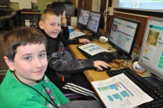 3rd graders Zachary Abouzeid and Jesse Schotte work on their Star Wars games at the Esten School Computer lab. photo by Maddie Gear
