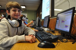 Esten Elementary 4th grader Cameron Frautten takes a break from coding activity in December. The computer classes in Rockland all participated in the Hour of Code as part of Computer Education Week. Lisa Ryan and Rachel Gear are instructors in the program. photo by Maddie Gear