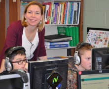 Esten Elementary 4th graders, Elias Nassif, left, and Logan Carnathan work on their coding tutorials under the direction of teacher Lisa Ryan. photo by Maddie Gear.