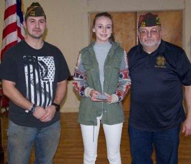 Meaghan McDonough came in first in the VFW Voice of Democracy contest. Her speech also was awarded first place in the Southeastern Mass. district and will now be judged at the state level. McDonough is a sophomore at Rockland High School. Her entry was sponsored by David Murphy, teacher and director of WRPS at Rockland High. Left is Old Colony Post 1788 Commander Joe Pollini and Voice of Democracy Chairman, Jeffrey Najarian. Veritas photo