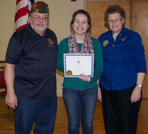 Rockland High School senior Sophie McLellan placed third in the Voice of Democracy contest sponsored by the Veterans of Foreign Wars. Old Colony Post 1788 Voice of Democracy Chairman Jeffrey Najarian and scholarship committee chairman, Claire Payne presented McLellan with a scholarship award at a ceremony on January 5 at the VFW hall in Rockland. Veritas photo
