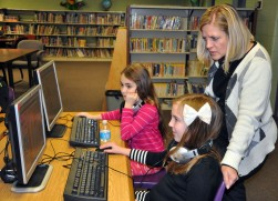 Mrs. Rachel Gear, Madeline Kearns (front) and Lilianna Regens work on coding on their computers at Esten Elementary School in Rockland. The students have been learning how to code all year and participated in An Hour of Code as part of Computer Education Week in December. photo by Maddie Gear.