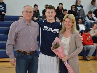 Jake Crawford and his parents on senior night