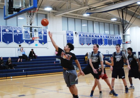 Anthony Vasquez goes in for the lay-up making it by Mr. Smith in the Nets for Nets tournament. Veritas photo