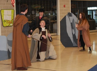 Aiden Glennon as Banquo is murdered by the murderers sent by Macbeth. From left they are Joe Naughton, Adam Dalton and Sabrina Sprague.