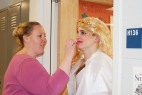 Ms. Walsh works on Thisbe's lipstick