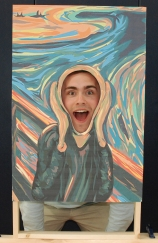 "Rockland High School's Adam Royle fits into Edvard Munch's ""The Scream"" painting at the Rockland Public School's annual district-wide arts festival last month. Madeline Gear photo"