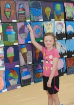 Madalyn Moriarty points to her drawing at the Arts Festival.