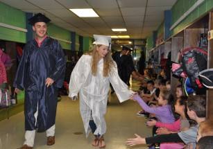 Adam Royle and Sydney Ferguson greet the elementary school children at Esten Elementary School
